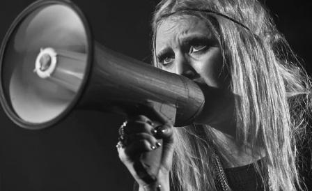 Lykke Li sings with megaphone.